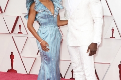 Regina King and Aldis Hodge arrive on the red carpet of The 93rd Oscars® at Union Station in Los Angeles, CA on Sunday, April 25, 2021.