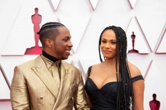 Oscar® nominee Leslie Odom Jr. and Nicolette Robinson arrive on the red carpet of The 93rd Oscars® at Union Station in Los Angeles, CA on Sunday, April 25, 2021.