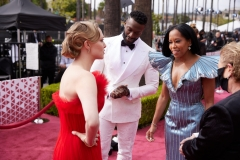 Oscar® nominee Amanda Seyfried (L) and Regina King (2nd from R) and guests arrive on the red carpet of The 93rd Oscars® at Union Station in Los Angeles, CA on Sunday, April 25, 2021.